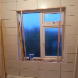 Tiling around the window